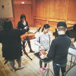 Alison Rowe, Lusha Anthony, Jiwon Kim, and Matthew Lau rehearsing local bond