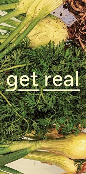 "Various fresh vegetables superimposed with the text ""get real"""